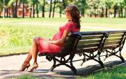 Pregnant woman on bench