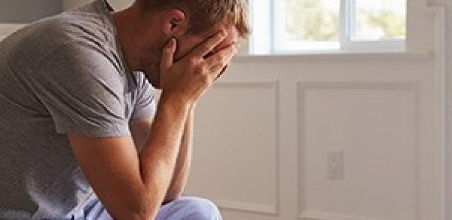 depressed man in pyjamas